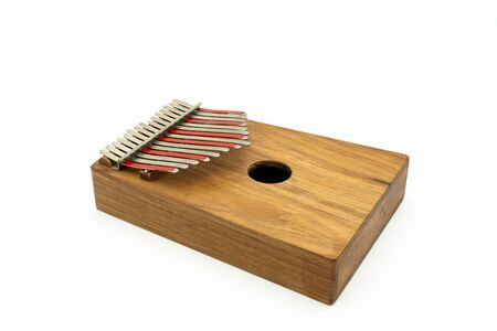 Details of a thumb piano (Kalimba, Mbira) with silver and red tines