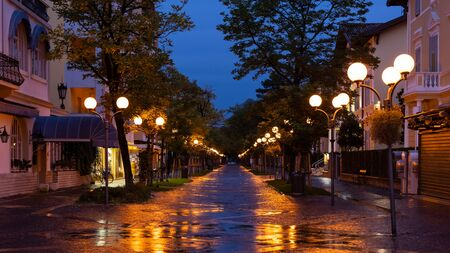 Street in Grado (Italy) during rainy night in autumn