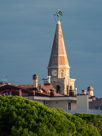 The church tower of Grado (Italy) on a sunny evening in late autumn