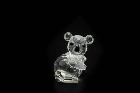 Closeup of a figurine of a bear made of glass