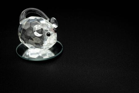Closeup of a figurine of a mouse made of glass