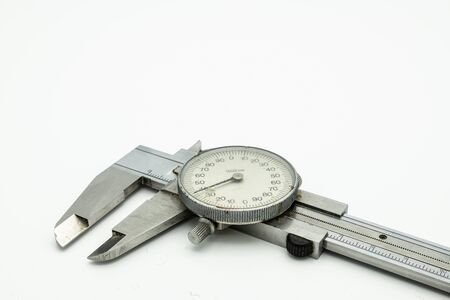 Closeup of a dial caliper lying on a white background 스톡 콘텐츠