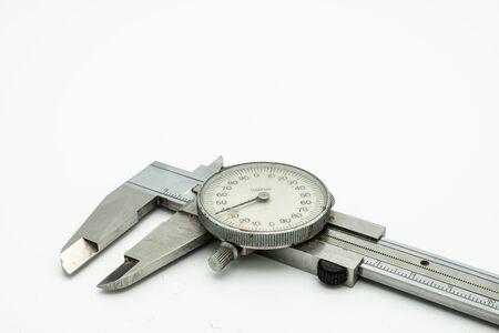 Closeup of a dial caliper lying on a white background Foto de archivo