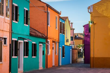 Colorful houses of Burano (Venice, Italy) on a sunny day in winter