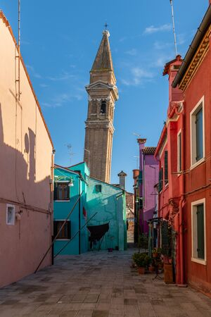 The leaning bell tower of Burano (Venice, Italy) on a sunny day in winter