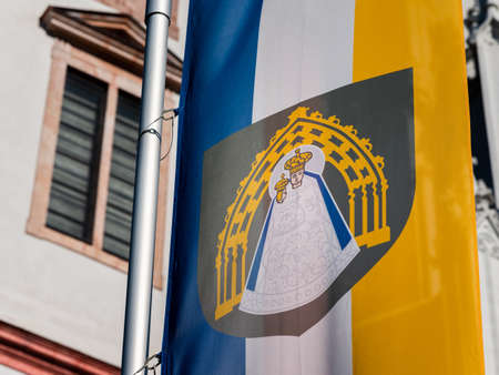 Flag of Mariazell in front Basilica of the Birth of the Virgin Mary (Austria)