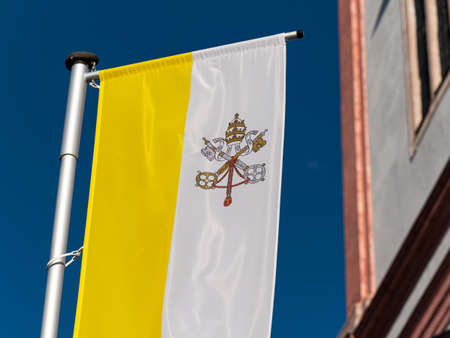 Flag of Vatican in front Basilica of the Birth of the Virgin Mary in Mariazell (Austria)