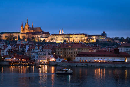River Vltava and castle of Prague (Czech Republic) in the evening in autumn