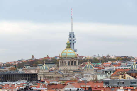Cityscape of Prague (Czech Republic) with National museum and Television tower on a cloudy day in autumn Redakční