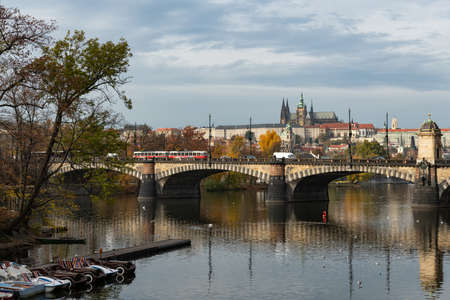 River Vltava and castle of Prague (Czech Republic) on a sunny day in autumn