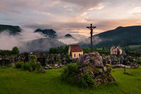 Mariazell, Austria - June 12, 2020: Graveyard of Mariazell on a cloudy evening in summer
