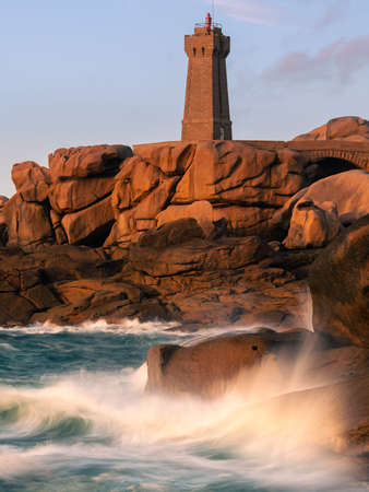 The pink granite lighthouse of Ploumanac'h (Brittany, France) stands in the middle of the chaotic rock formations formed by the erosion of cooled magma then shaped by the rain, salty sea spray and wind. Its name comes from the Breton