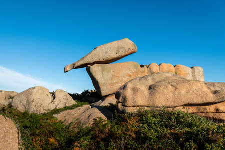 Interesting rock formation (bottle) on Pink Granite Coast in northern Brittany (France), on a sunny day in summer