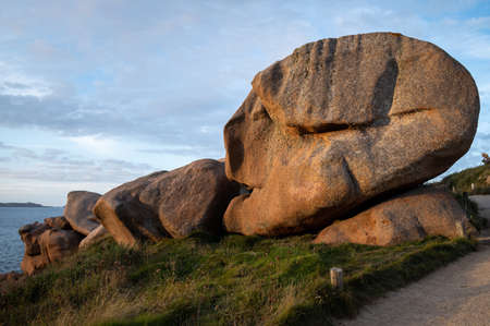 Interesting rock formation (skull) on Pink Granite Coast in northern Brittany (France), on a sunny day in summer