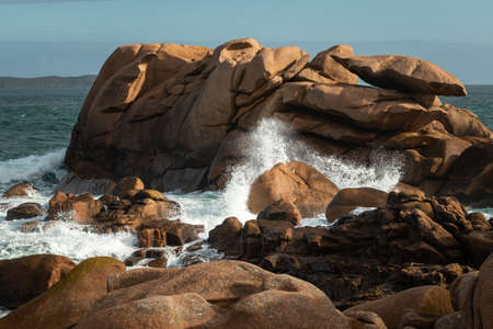 Interesting rock formation on Pink Granite Coast in northern Brittany (France), on a sunny day in summer