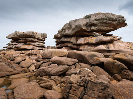 Interesting rock formation (pancakes) on Pink Granite Coast in northern Brittany (France), on a sunny day in summer