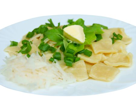 traditionally russian: Dumplings with salad on plate on white background