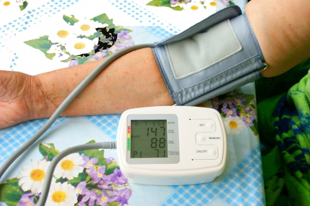 Hand of the person measuring pressure by medical instrument