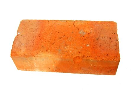 Old red brick isolated on white background photo
