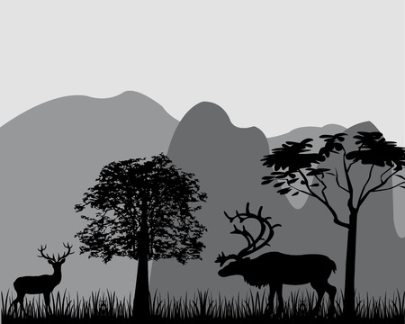 Silhouettes of the deers on background of the mountains.