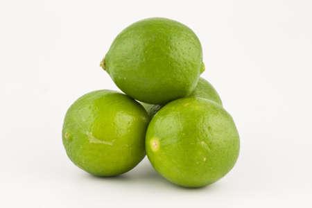 Four Green Lemons Фото со стока
