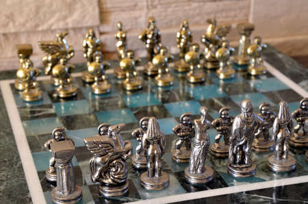 Marble chess set with silver and gold figurines photo