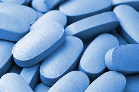 Medical blue pills macro background photo