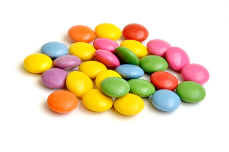 Pile of colored smarties on white background