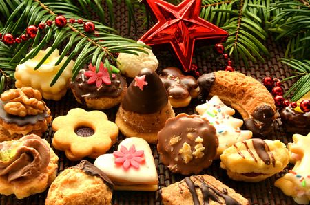 Christmas sweets, cookies, decoration and needles photo
