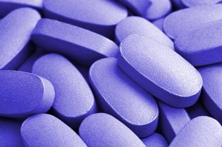 erectile: Medical blue pills macro background