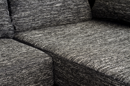 Detail to part of black and white cloth sofa photo