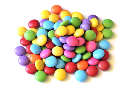 dragee: Isolated heap of colored smarties on white background Stock Photo