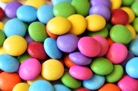 Macro detail of pile of colored smarties background
