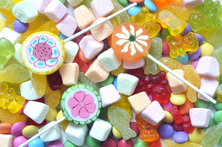 smarties: Candy, lollipop, colored smarties and gummy bears background