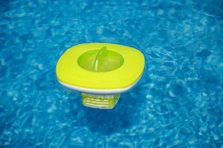 green chemistry: Green chemistry dispenser in the pool Stock Photo