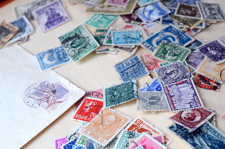 Collection of old postage stamps close-up detail Imagens