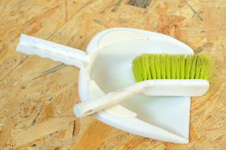 osb: Plastic brush and dustpan placed on OSB board Stock Photo