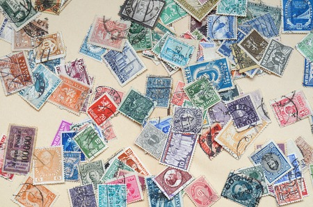 Collection of old postage stamps close-up detail