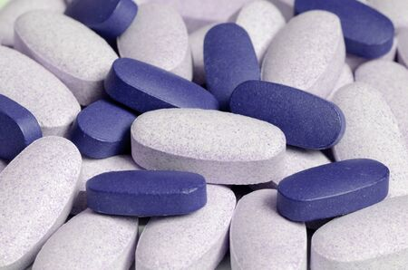 impotence: Close-up of blue and white pills Stock Photo