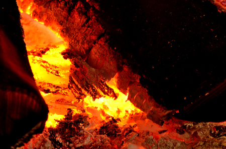 embers: Close-up detail of hot wood and embers in fireplace