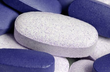 impotent: Close-up of blue and white pills Stock Photo