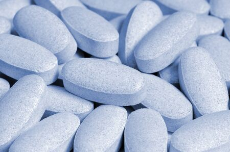 impotent: Close-up of light blue pills