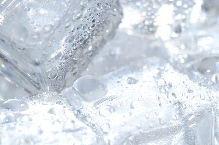 liquid reflect: Macro detail of ice cubes with water droplets Stock Photo