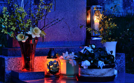 all souls' day: Mysteriously illuminated grave on All Souls Day at night Stock Photo
