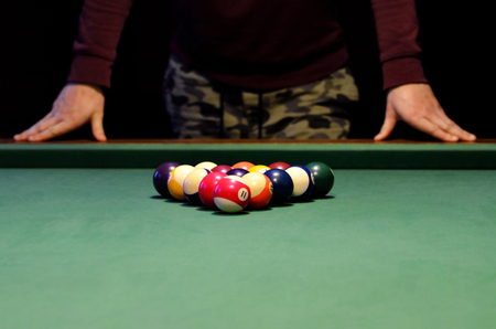 snooker rooms: Pool player standing in front of balls before the first poking Stock Photo