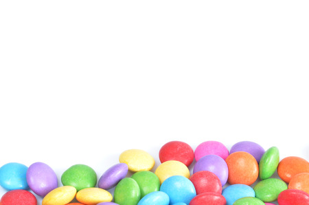 smarties: Isolated heap of colored smarties on white background shape like lower frame