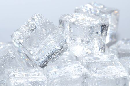liquid reflect: Macro detail of group of ice cubes with water droplets