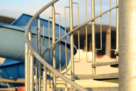 Detail Of Spiral Stairs To Blue Water Slide At Sunset Stock Photo   61917910