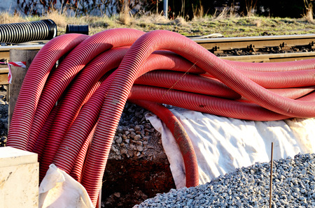 hoses: Red plastic hoses on construction site on railway station