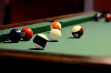 pool balls: Close-up of pool table with pool balls and cue ball Stock Photo